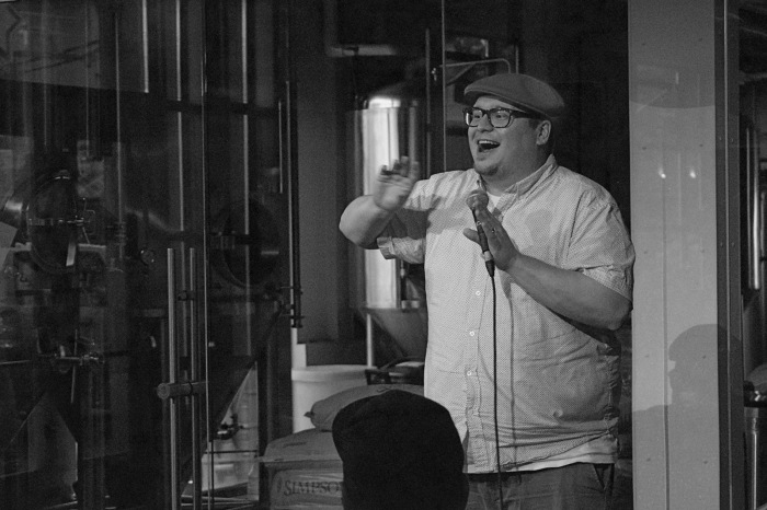 Charlie Demers on stage at Full Pint Comedy