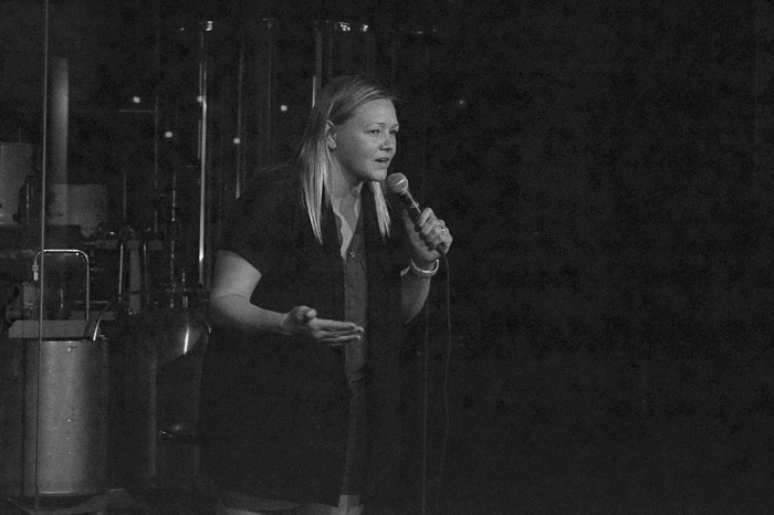 Erica Sigurdson on stage at Full Pint Comedy