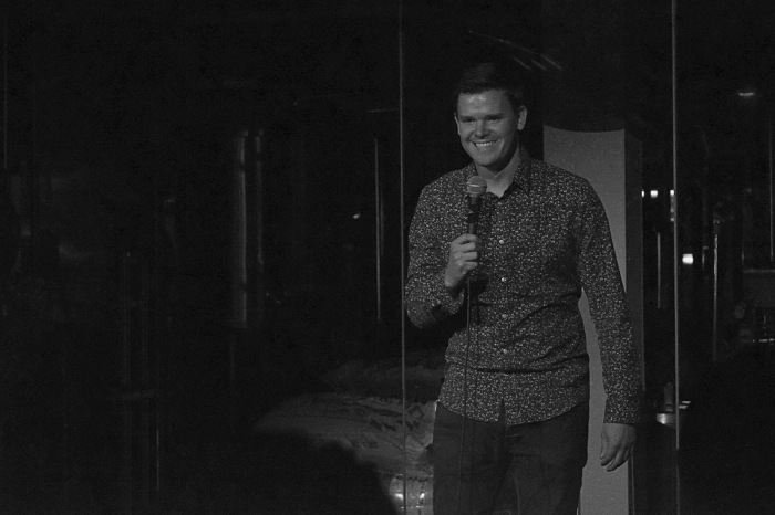 Ivan Decker on stage at Full Pint Comedy
